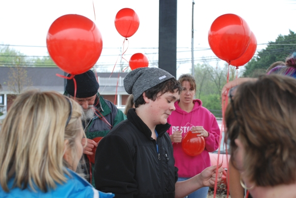 14-year old Anthony Gayla  with friends and family ready to release red balloons