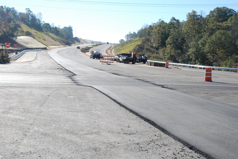 Contractor Begins Laying Down Smooth Layer Of Asphalt On Appalachian Parkway Project